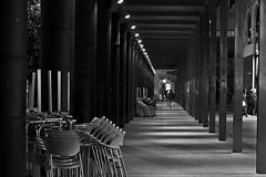Chairs (Daniel Nebreda Lucea) Tags: night noche chairs sillas bar pub perspective perspectiva composition composicion travel viajar black white blanco negro monochrome monocromatico lights luces city ciudad street calle canon 60d 50mm zaragoza aragon spain europe europa españa urban urbano metallic metalico texture textura life vida