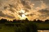 Sunset over Zaanse Schans. (Alex-de-Haas) Tags: dutch holland hollandseluchten nederland netherlands noordholland zaanseschans clouds gras grass grasslands landscape landschap licht light meadow meadows oerhollands skies sky summer sunny sunset sunsetlight weiland weilanden wolken zomer zonnig zonsondergang