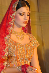 Gaudy (Ariaana) Tags: pakistan red orange woman girl fashion bride model designer jewellery modelling lahore meeras pakistanfashion ariaana neelofershahid
