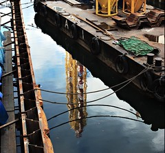 Barge (JanneM) Tags: city autumn reflection water wheel yellow japan river jan ferris   don osaka kansai quixote doutonbori  morn moren k10d janmoren janmorn