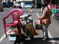 chair on a scooter (hey-gem) Tags: street people rural person chair candid taiwan scooter cardboard transportation vehicle boxes tainan moped provincial misadventuresintaiwan