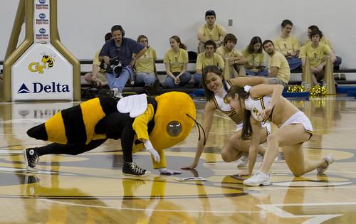 Georgia Tech Cheerleaders and mascot at a basketball game.