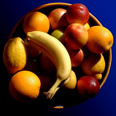 fruity (Harry Halibut) Tags: blue red orange sunlight green apple yellow lemon bowl banana onion lime nectarine allrightsreserved furit ©andrewpettigrew kazoo300
