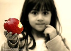 you want a bite ? (Abdullah AL-Naser) Tags: red blur apple fruit canon kid interesting focus bravo child innocent sharp bite kuwait kuwaiti kuwaitvoluntaryworkcenter