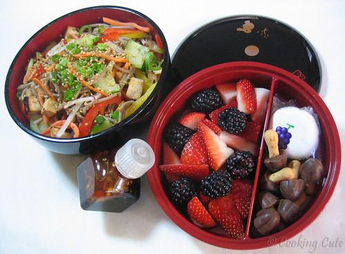 [bento bowl set with soba noodles, tofu and veggies, sauce, fruit, candy]
