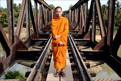 Bridge:  Battambang (mboogiedown) Tags: world travel bridge light smile season asia cambodia cambodian buddhist faith religion perspective belief dry monk buddhism experience southeast harsh monastic battambang developing ratha dhamma kampuchea cambogia khmersmile travelforpeace camboge soksabay beatravelernotatourist itsallaboutthepeople reasontolearnkhmer peopleiwillneverforget savanaphum ifthephotographerisinterestedinthepeopleinfrontofhislensandifheiscompassionateitsalreadyalottheinstrumentisnotthecamerabutthephotographerevaarnold