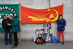we'll keep the red pants flying here (dr_loplop) Tags: red london hammer square star war banner trafalgar biting demonstration nails trousers sickle wandsworth trident communists