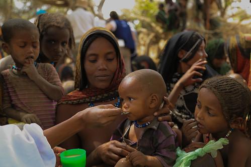 A mobile health extension worker feeding porage to Urru Awka 1 at Lubakda Kebele of Kori Woreda in Afar Regional state.