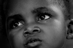 two big eyes (janchan) Tags: poverty africa portrait people blackandwhite kids children eyes retrato refugee refugees documentary ghana ritratto reportage povert pobreza refugeecamp buduburam whitetaraproductions