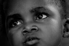 two big eyes (janchan) Tags: poverty africa portrait people blackandwhite kids children eyes retrato refugee refugees documentary ghana ritratto reportage povert pobreza refugeecamp buduburam whitetaraproductions