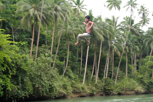 A boy dives into the river in Loboc, Bohol