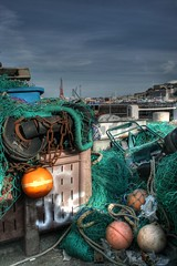 Fishing Nets (jerseyimage) Tags: greatbritain color colour green canon outside outdoors islands pier chains day harbour jersey nets netting buoys hdr channelislands channel verticle sthelier dumped fishingnets victoriapier buoyant rustychains 400d j65 jerseyimage markerbuoys