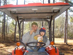 Two Guys Eatin' Goldfish on a Tractor