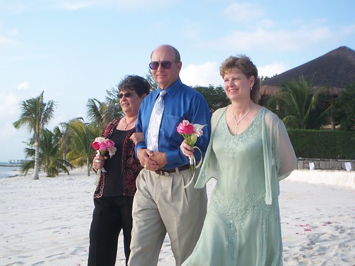 the groom\'s parents and the bride\'s mother