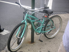 a sea green bike