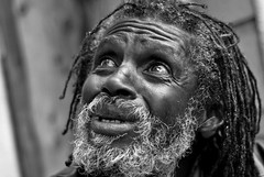 awaken! (stoneth) Tags: poverty sf sanfrancisco california ca street portrait people urban blackandwhite bw white man black male eye beautiful face closeup hair beard person blackwhite eyes nikon head homeless poor photojournalism streetportrait forsakenpeople social impoverished 2006 human d200 grayscale nikkor 50mmf18d nagasaki dredlocks destitute streetshot nikond200 seenthegod