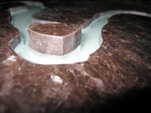 Close up of the waterjet cut granite and glass