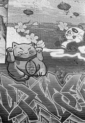 Neko Kitty (Georgie_grrl) Tags: 7thanniversarywalk torontophotowalks social photographers friends toronto ontario topwa7 pentaxk1000 rikenon12828mm graffiti mural blackandwhite nekokitty goodluck goodfortune
