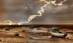 A storm is looming (blueeyeddebby) Tags: storm lightening boats interestingness114 interestingness60 interestingness58 interestingness37 explore09dec2006 i500 instantfav anawesomeshot