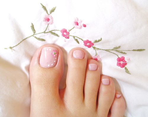 Pink flowers toe nail polish and art design