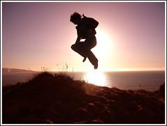 Time to... jump! (loquenoves) Tags: chile sunset sun backlight contraluz lights jump dunes 2006 arena explore latinoamerica boris salto horizonte dunas espigas saltar abigfave impressedbeauty 15challengeswinner ganadorjpiter boriszamora