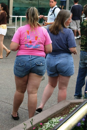 Two fat women in denim shorts and tees