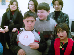 ICT4D Mental Discapacity Student-Syria holding...