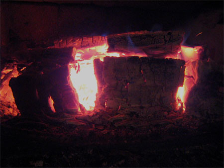 A cavern of fire appears in my woodstove.