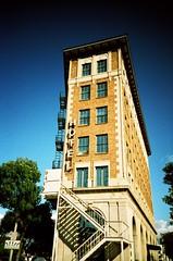 Culver City Hotel (lomojunkie71) Tags: california blue trees sky sign stairs hotel losangeles lomo lca xpro vignette culvercity kodakelitechrome lomokompaktautomat
