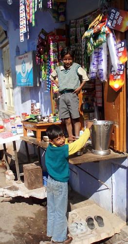 children in front of their shop