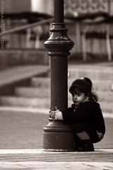 So Lonely (Ammar Alothman) Tags: life portrait people blackandwhite bw baby girl kids canon lost kid interestingness interesting bravo flickr gulf calendar explore lonely kuwait 70200 ammar kuwaitcity kw 2007 q8 30d canon70200  canon30d magicdonkey  ammaralothman fivestarsgallery  kuwaitvoluntaryworkcenter