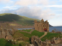 Urquhart Castle, Loch Ness (Tracey Paterson) Tags: winter sky castle history water stone clouds landscape scotland highlands scenery rocks ruin structure hills paths walls loch historicscotland urquhartcastle lochness canonpowershots3is