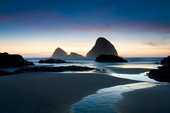 Oceanside Blues (realkuhl) Tags: ocean copyright oregon john landscape coast twilight rocks all  photograph rights reserved facebook blueribbonwinner lehmkuhl oceansidebeach abigfave superaplus aplusphoto realkuhl johnlehmkuhlcopyright2007allrightsreserved