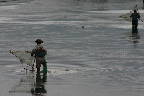 Local fishermen at work in the dammed lake...