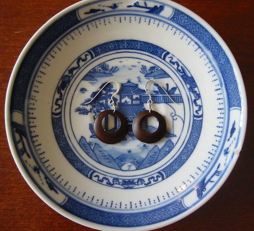 earrings for peace on a blue willow saucer