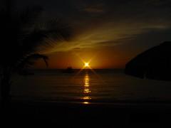 RETRO: sunset at pigeon point (archerfish) Tags: light sunset reflection beautiful umbrella colours dusk cybershot palmtree trinidad caribbean pigeonpoint tobago silouettes