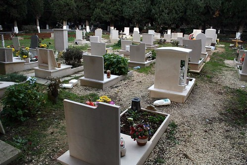 Gravestones, and jars left for watering flowers