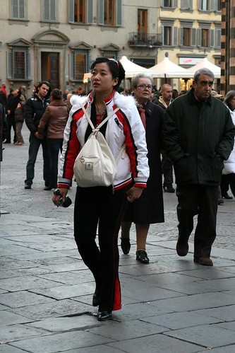 The Asian tourists are wearing their purses oddly this season
