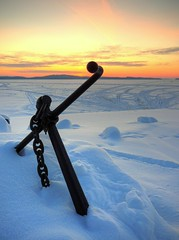 anchor. (jazoni) Tags: blue winter sunset sky orange lake snow topf25 tracks anchor february snowmobile specobject twtmeiconoftheday impressedbeauty