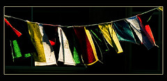 Flags of Buddha (Small the Beetle) Tags: colours bestviewedlarge flags highlights prayerflags flap silverlining