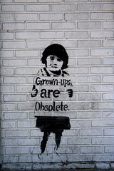 grownups (niznoz) Tags: city nyc usa streetart ny newyork brick childhood wall canon geotagged graffiti chinatown child borf thepleasuresofthetext digitalrebelxt grownups 10002 grownup canondigitalrebelxt geolat40713348 geolon73992876 streetartistborf