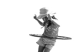 New hat and a hula hoop (fd) Tags: family bw hat topf50 topv333 candid daughter suburbs hoopgallery hulahoop