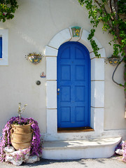 Blue Door in Kefalonia, Greece (mnadi) Tags: door blue architecture island islands village pot greece kefalonia assos   cefalonia boukamvilies nikonstunninggallery