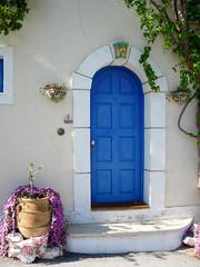 Blue Door in Kefalonia, Greece (mnadi) Tags: door blue architecture island islands village pot greece kefalonia assos   cefalonia boukamvilies nikonstunninggallery