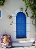 Blue Door in Kefalonia, Greece (mnadi) Tags: door blue architecture island islands village pot greece kefalonia assos باب أزرق cefalonia boukamvilies nikonstunninggallery