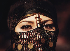 Arabian Eyes (mnadi) Tags: portrait people woman black macro eye sahara girl beauty smile face closeup topv2222 lady eyes women pretty veiled veil dress desert head handmade topv1111 traditional topv999 egypt hijab makeup tribal east exotic cairo arab modesty vodafone mascara accessories local arabian middle tribe piece niqab ethnic eastern sharm taba sinai bedouin middleeastern kohl accessory arabs maskara jewelryornaments