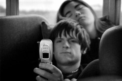 missy and andrew (world_of_noise) Tags: missy andrew cellphone sprint bus eugene sexyasians bw pentax me super dof
