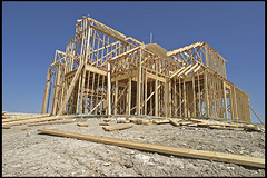 McHouse Under Construction (Dean Terry) Tags: wood house construction texas suburbia documentaryfilm suburbs plano sprawl cookiecutter mcmansion subdivision urbansprawl deanterry subdivided mchouse mcmansionization
