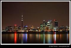 Toronto skyline (xSilentRob) Tags: toronto skyline cntower lights reflection buildings skyscrapers night lakeontario downtown docks