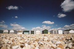 polarizer beach huts at shoreham (lomokev) Tags: blue sky beach topf25 clouds stones huts hut beachhut top20landscape polarizer beachhuts eos1 circularpolarizer themecalming flickys excellenceinsets  deletetag canonef2035mmf3545usm publishedinjpg rota:type=landscape rota:type=showall rota:type=accessories file:name=eos0605132 use:on=moo posted:to=tumblr image:selection=tombing